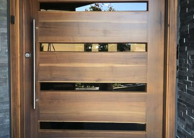 HolbrooksHeirlooms-Single pivoting hinge 6 foot opening 2.5thick walnut door (web)
