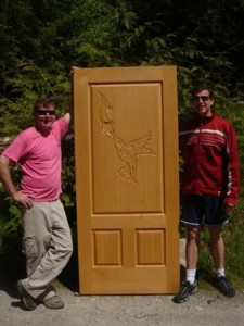 Hummingbird+carved+into+old-growth+fir+doors.+Paul+and+Mastercarver+Byron+Fader+(1-604-413+1726)
